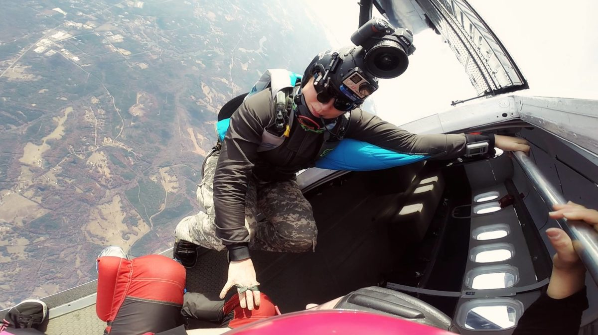 LP poised in the door of the aircraft at 14,000 feet capturing photos and video.