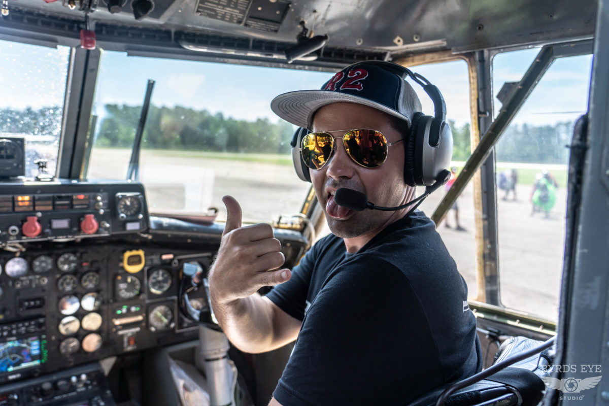 Skydiving Pilot giving a thumbs up in the cockpit.