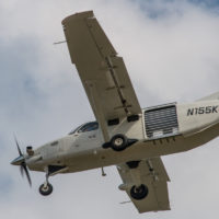 A white Kodiak skydiving jump plane flying through the sky