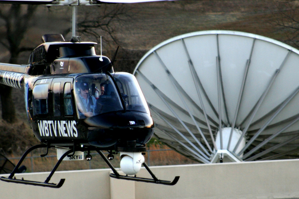 Rudy flying a news helicopter.