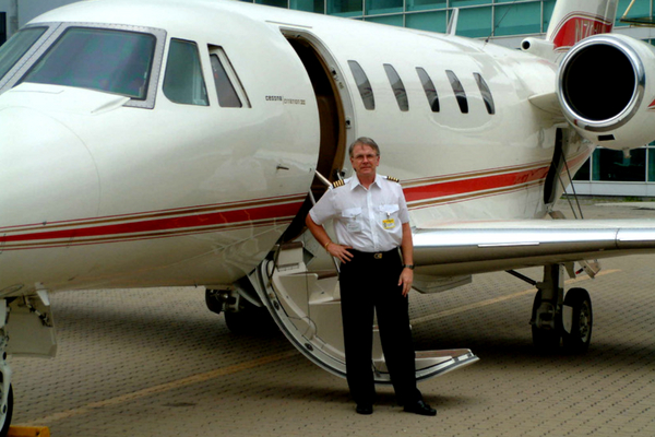Rudy photographed next to a jet in Hong Kong