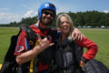 "Tandem Instructor, Dave Fulk gives a ""thumbs up"" after a skydive."