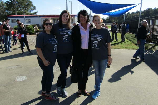 four women in Easterseals Jump for Charity shirts at Skydive Carolina