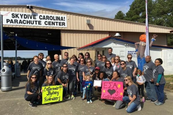group shot of Easterseals SC charity jump at Skydive Carolina