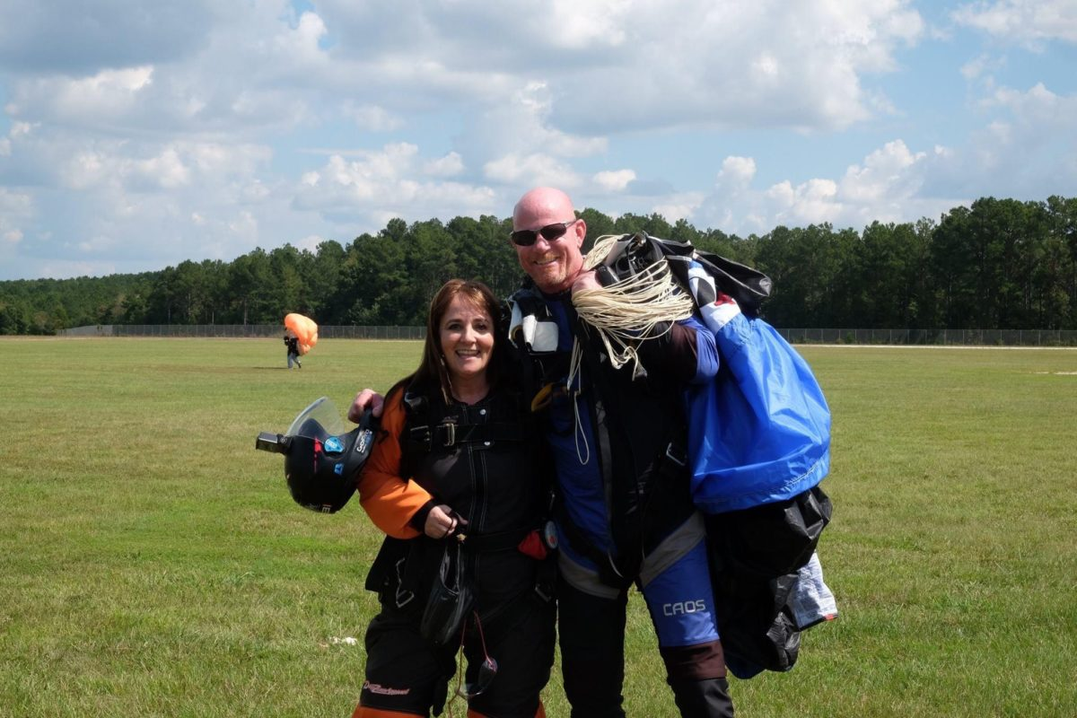 Tina gives a thumbs up after landing from her tandem skydive