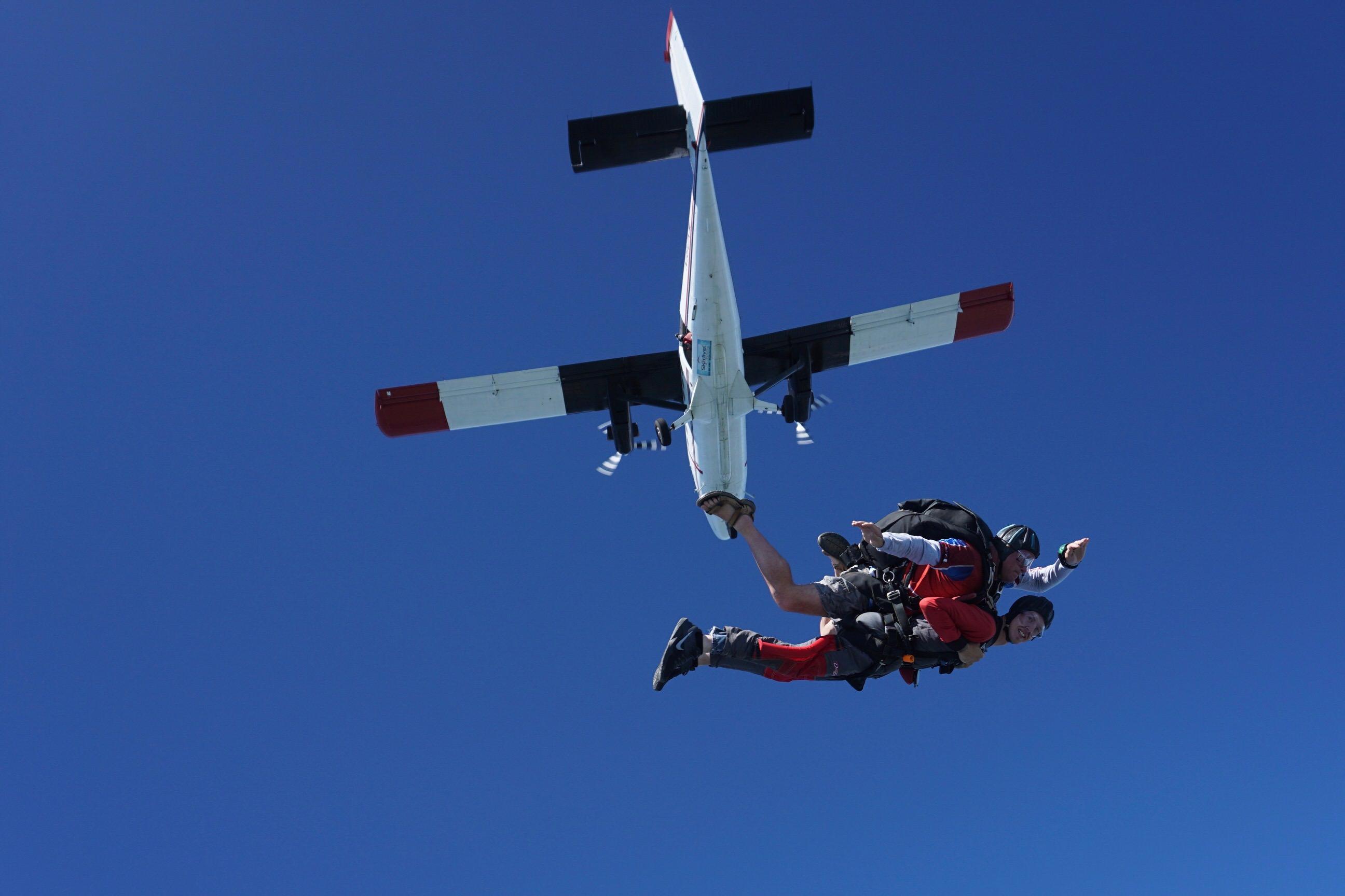 A tandem student exits an airplane at Skydive Carolina!