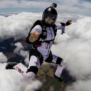 melissa nelson lowe skydiving among clouds