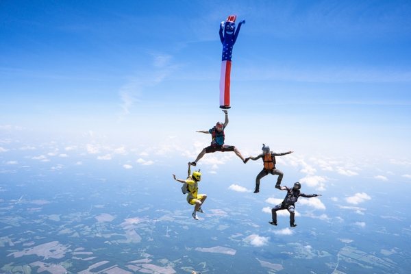 experienced jumpers execute advanced maneuvers in freefall