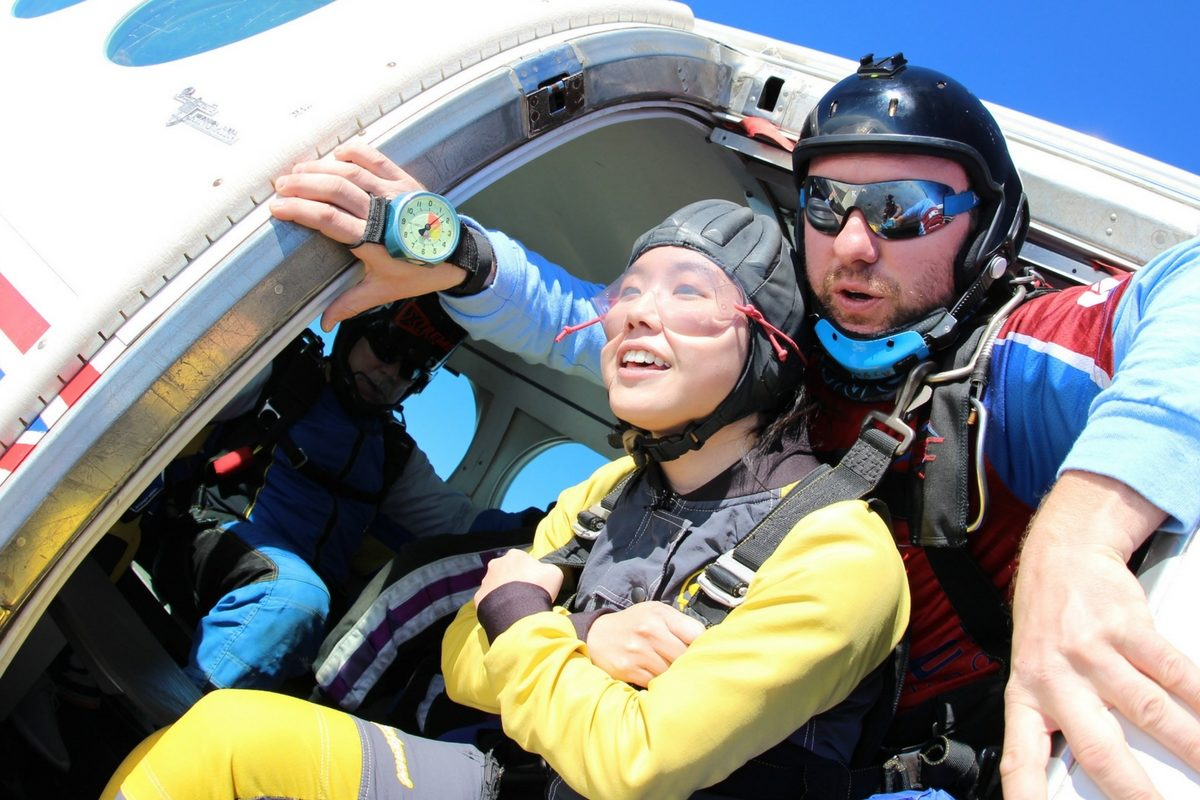 woman about to exit for tandem skydive