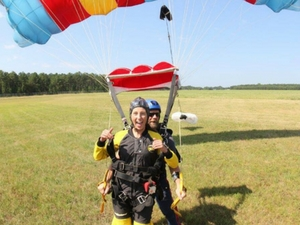 tandem jumper smiles after landing