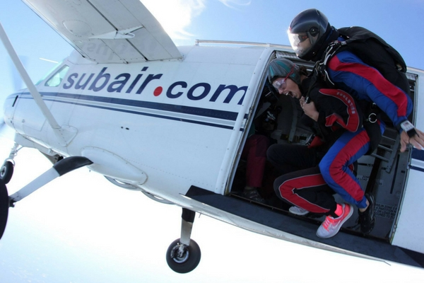 woman scared as she exits skydiving plane